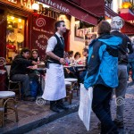 http://www.dreamstime.com/stock-photos-waiter-invites-couple-his-restaurant-montmartre-paris-evening-scene-smiling-passing-front-cafe-other-couples-image42420703